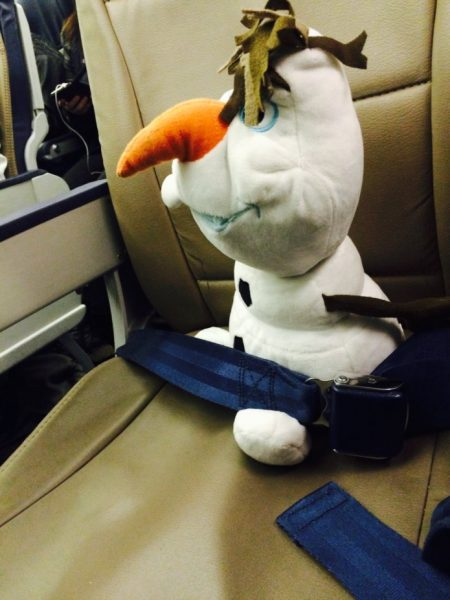 Olaf on the plane 450x600 - Complete guide to flights for your Disney World trip
