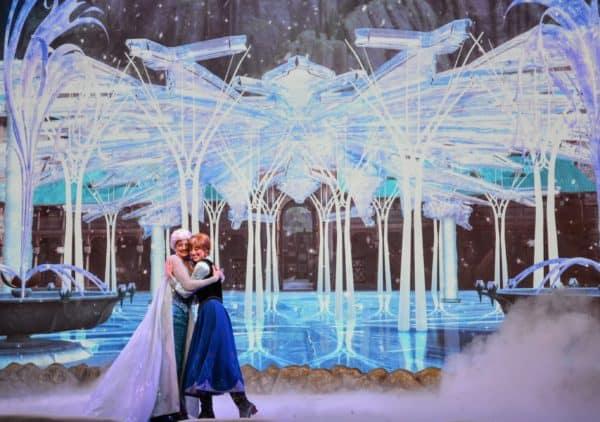 Anna and Elsa hugging at Frozen Sing-Along