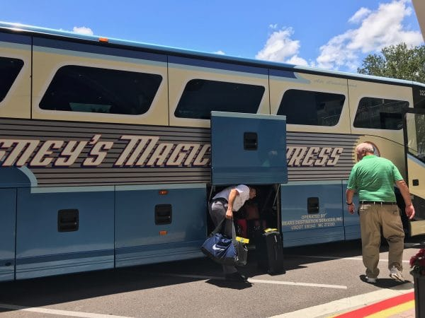 Magical Express loading bus