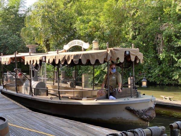 jungle cruise boat with skipper in mask
