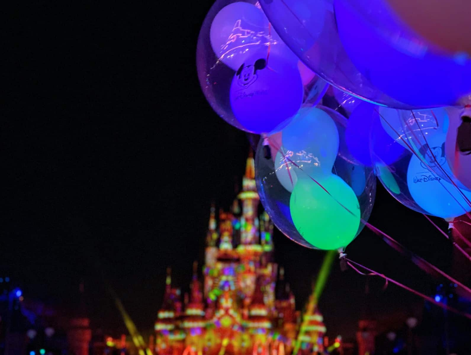 cinderella castle at night balloons walt disney world magic kingdom
